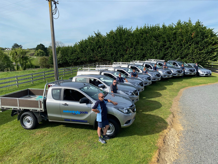 line up of staff & vehicles - swimming pool installation - Swimmingly Pools